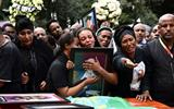 Families of victims of Ethiopian plane crash are given black soil for burial ceremonies.
